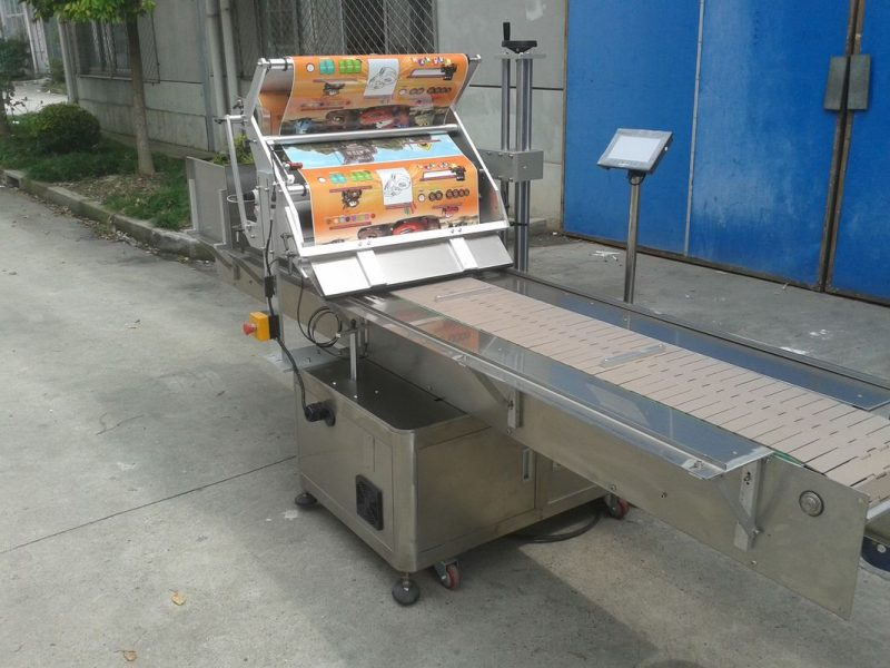 China Table Top Self Adhesive Sticker Flat Surface Label Applicator With Paging Machine Feeding Objects supplier