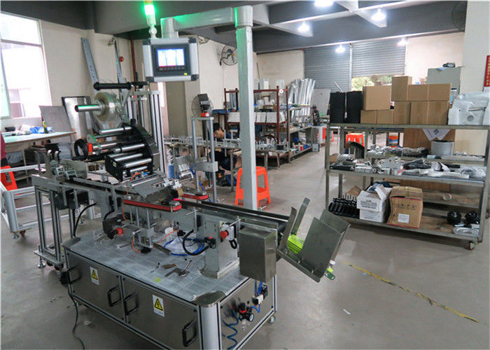 China Auto Top Labeling Machine Flat Surface Label Applicator With Conveyor / Top Labeling Equipment supplier