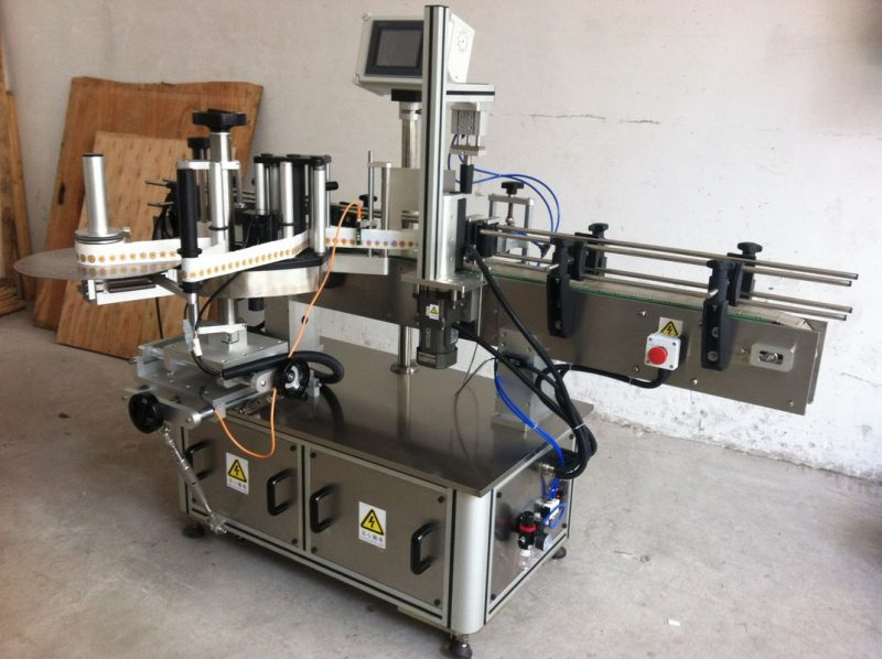 China Round Bottle Sticker Labeling Machine Wrap Around Label Applicator supplier